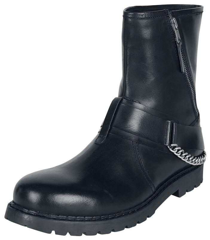 Mustat bootsit vetoketjuilla, koristesoljilla ja ketjuilla