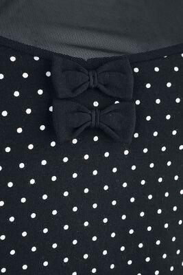 Musta T-paita valkoisilla pilkuilla ja läpikuultavalla pääntiellä